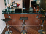 Custom Features: glass bar top with stainless steel standoffs